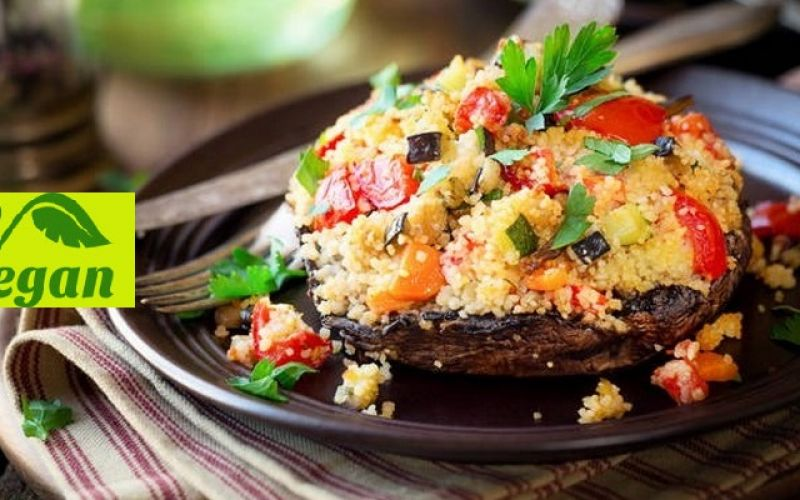 Stuffed mushrooms, with couscous, tomatoes and avocado